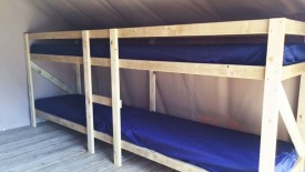 Bunks inside tent accommodation